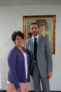 Adam Miller with Angie Johnson, President of the Fort Worth Chapter of the BYU Management Society following a fireside at the Arlington Stake Center on June 29, 2014.