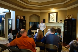 Adam Miller introduces Julie Smith to Miller Eccles Study Group Texas at a study group meeting in Arlington, Texas, on April 25, 2015.
